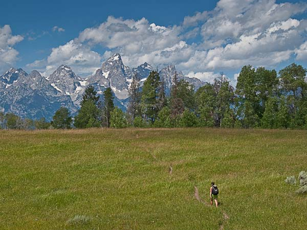 Woman hiking near the Tetons.